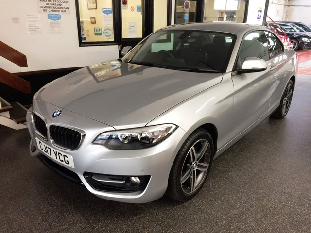 """USED 2017 17 BMW 2 SERIES 1.5 218I SPORT 2d 134 BHP One private owner & Full BMW service history. This 2 Series Coupe is finished in metallic silver with black/red leather heated seats. It is fitted with power steering, remote locking, electric windows, power fold mirrors, dual zone climate control, cruise control, front and rear parking sensors, Satellite Navigation, Bluetooth, Day lights, auto lights and wipers, 17"""" 5 spoke alloy wheels, DAB CD Stereo with USB & Aux ports and more. It has had one private owner from new and BMW history."""