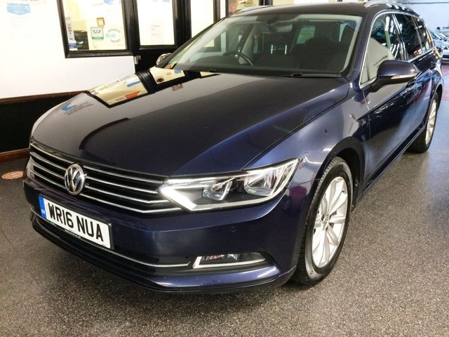 """USED 2016 16 VOLKSWAGEN PASSAT 2.0 SE BUSINESS TDI BLUEMOTION TECHNOLOGY 5d 148 BHP Estate Car and only £20 road tax! This 2.0 TDi 6 Speed manual SE Business Model is finished in Night Blue metallic with grey cloth  seats. It is fitted with VW Sat Nav/D.A.B./Phone, front and rear park assist, cruise control multi function computer, fogs, remote locking, electric windows and power fold mirrors, 17"""" 10 spoke alloy wheels with space saver spare wheel, USB aux port and more. It has had 1 company owner from new and comes with a documented service history done at VW."""
