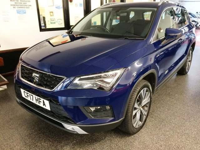 "USED 2017 17 SEAT ATECA 1.4 ECOTSI SE TECHNOLOGY 5d 148 BHP This petrol ATECA SE  TSi Tech Pack 150 BHP is finished in Mediterranean Blue with chrome pack and  18"" 5 Spoke split Alloys along with grey cloth seats. It is fitted with power steering, remote locking, LED lights, hill assist, cruise control, electric windows and power fold mirrors, isofix, Air Conditioning, SEAT Tech pack including Navigation, Bluetooth, DAB Radio with USB Aux port and more. It has had One owner from new.  It comes with a full Seat service history."