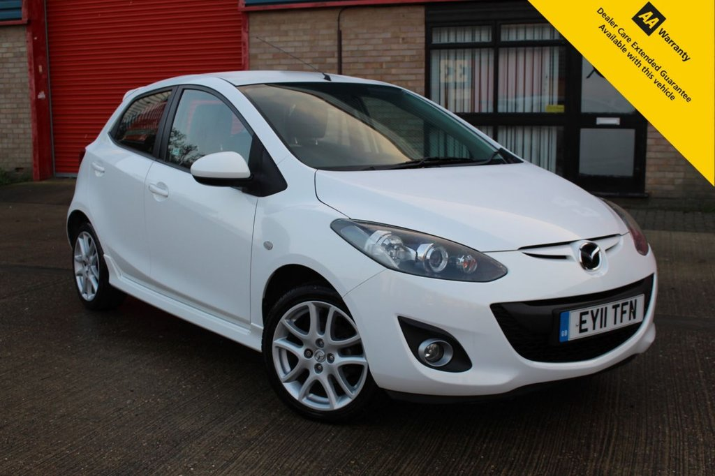 USED 2011 11 MAZDA 2 1.3 TAKUYA 5d 83 BHP ** FRESHLY SERVICED + NEW SPARK PLUGS ** BRAND NEW ADVISORY FREE MOT ** CRUISE CONTROL ** BLUETOOTH ** BRAND NEW FRESHLY REFURBISHED ALLOY WHEELS ** STUNNING PEARL WHITE PAINT ** ONLY £30 ROAD TAX ** ULEZ CHARGE EXEMPT ** LOW RATE £0 DEPOSIT FINANCE AVAILABLE CLICK & COLLECT + NATIONWIDE DELIVERY AVAILABLE **