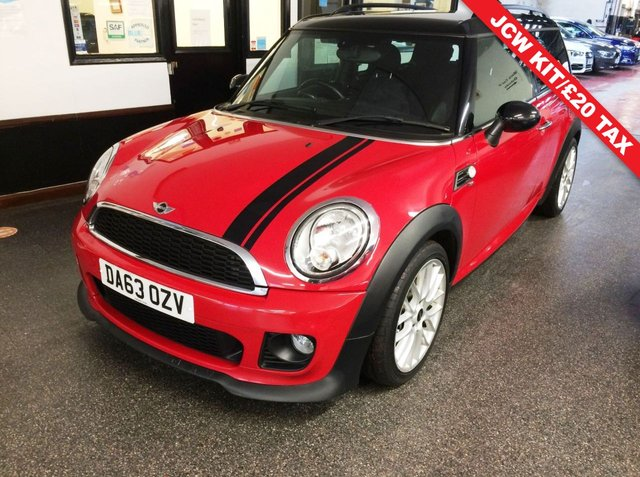 "USED 2013 63 MINI CLUBMAN 1.6 COOPER D 5d 112 BHP This Clubman is finished in Chilli Red with black Roof and mirror caps, along with John Cooper Works badging and Mini Ltd Edition decals. Its fitted with a Chilli pack so has a Black leather & cloth interior. It is fitted with power steering, mini mood lighting, remote locking, electric windows and mirrors, JCW steering wheel, door inserts and badging,  climate control, cruise control, roof rails, Bluetooth, 17"" alloy wheels,  CD Stereo with Aux & USB ports and more."