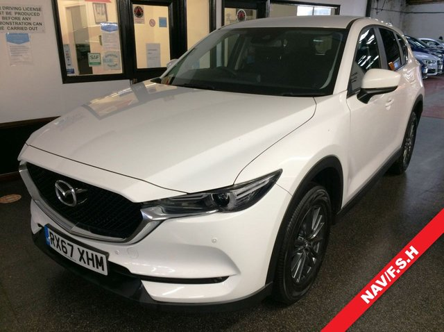 USED 2017 67 MAZDA CX-5 2.0 SE-L NAV 5d 163 BHP Supplied with new front brake pads and two new front tyres. This 1 owner petrol powered Mazda CX5 SE - L SUV is finished in White with Black cloth seats, privacy glass and Anthracite Grey alloy wheels. It is fitted with power steering, Mazda Navigation, cruise control,  remote locking, electric windows and mirrors with power fold, climate controlled air conditioning, Bluetooth, front and rear park assist, alloy wheels, privacy glass, LED lights,  DAB Stereo with USB & Aux port and more.