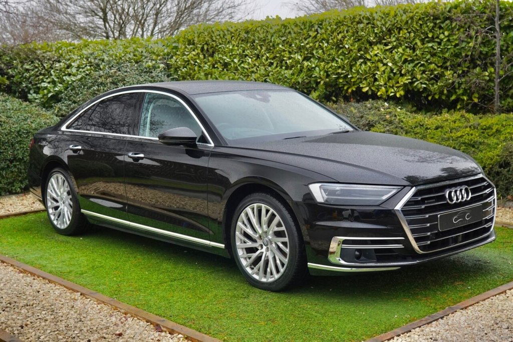 USED 2018 68 AUDI A8 3.0 TDI QUATTRO 4d 282 BHP Truly Remarkable Audi A8 Finished in Mythos Black Metallic with Black Full Leather Heated Electric Memory Seats.In Excellent Condition Throughout with a Superb Specification with FMDSH: MMI Satellite Navigation + Heads up Display + Audi Virtual Cockpit + Bang & Olufsen Premium Sound + DAB Radio + Apple CarPlay, Bluetooth Connectivity + Audi Phone Box + Wireless charging, Panoramic Glass Roof, Remote Power Tailgate, Audi Drive Select, Comfort and Sound Pack, Automatic Bi-Xenon Headlights,