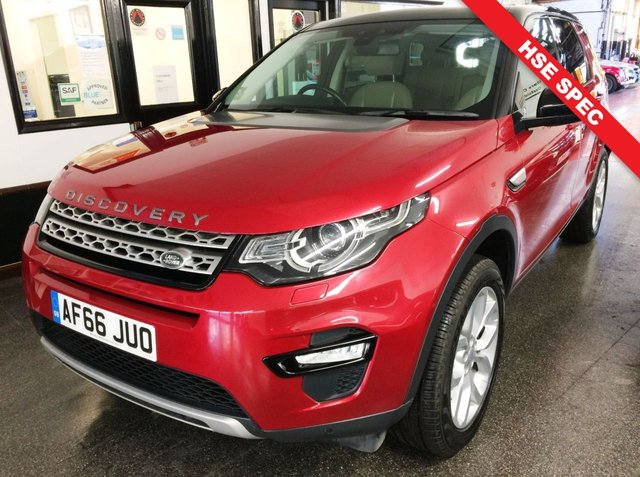 USED 2016 66 LAND ROVER DISCOVERY SPORT 2.0 TD4 HSE 5d 180 BHP Complete with 12 months Insured RAC warranty. This HSE 7 Seater Automatic with paddleshift  Discovery Sport is finished in Metallic Firenze Red with Full Black contrast roof along with glass panoramic roof and mirror caps.  The inside has hot and cold beige leather seats (front) that are electric. It is fitted with power steering, remote locking, electric windows, mirrors with power fold and tailgate, dual zone climate control, cruise control, front and rear park sensors with camera + more.