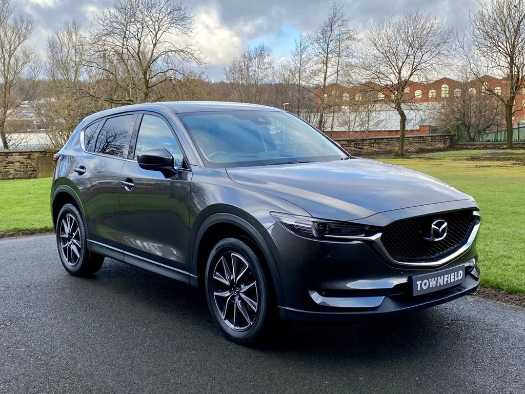 USED 2017 67 MAZDA CX-5 2.2 D SPORT NAV 5d 148 BHP A Superb Example with Automatic Transmission and a Extensive Specification. Finished in Metallic Grey with Black Full Leather Heated Electric Memory Seats + Contrast Stitch, Head Up Display, Satellite Navigation + BOSE Premium Sound + Bluetooth Connectivity, Heated Leather Multi Function Steering Wheel, Remote Power Tailgate, Automatic Bi-Xenon Headlights + Power Wash, Front and Rear Park Distance Control + Reverse Camera, 19 Inch Alloy Wheels, Heated Electric Powerfold Mirrors, Privacy Glass