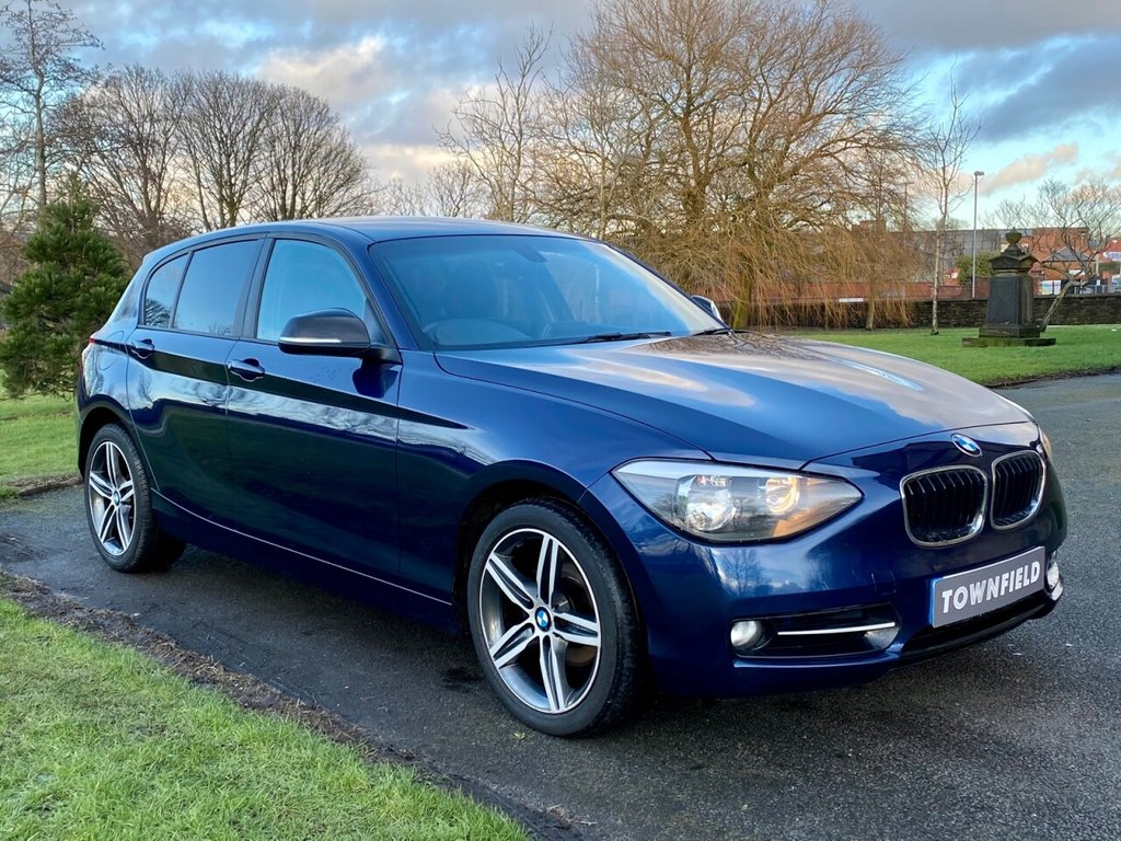 USED 2014 14 BMW 1 SERIES 2.0 116D SPORT 5d 114 BHP A Superb Example with Adjustable Driving Dynamics and Just £30 Road Tax Per Year. Finished in Metallic Blue with a Great Specification to Include: HDD Satellite Navigation + Bluetooth Connectivity + DAB Radio, Adjustable Driving Dynamics, Air Conditioning, Leather Multi Function Steering Wheel, Privacy Glass, On-board Computer, Automatic Headlights, Start / Stop Fuel Saving Technology