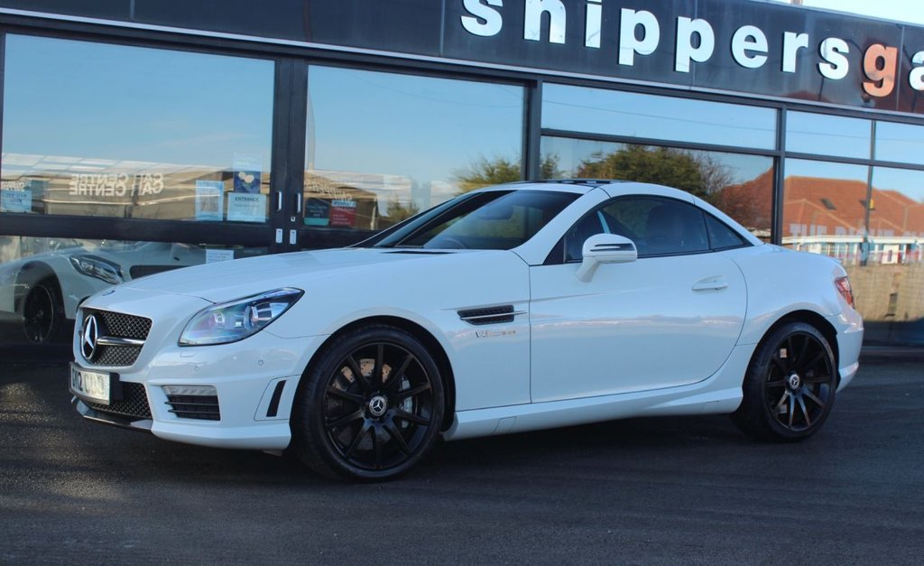 USED 2012 12 MERCEDES-BENZ SLK 5.5 SLK55 AMG 2d 421 BHP Calcite White, Fun Red Nappa Leather, Airscarf, Glass Roof,  Parking Guidance, Command DVD With Navigation, Heated Seats, Transparent Wind Deflector, LED Daytime Running Lights, Electric Adjustable Seats With Memory, Electric Folding Mirrors, Auto Dimming Mirrors, Memory Package, Tyre Pressure Loss Warner, Traffic Sign Recognition, Bluetooth Phone, 2 Keys and Book Pack, Full Service History.