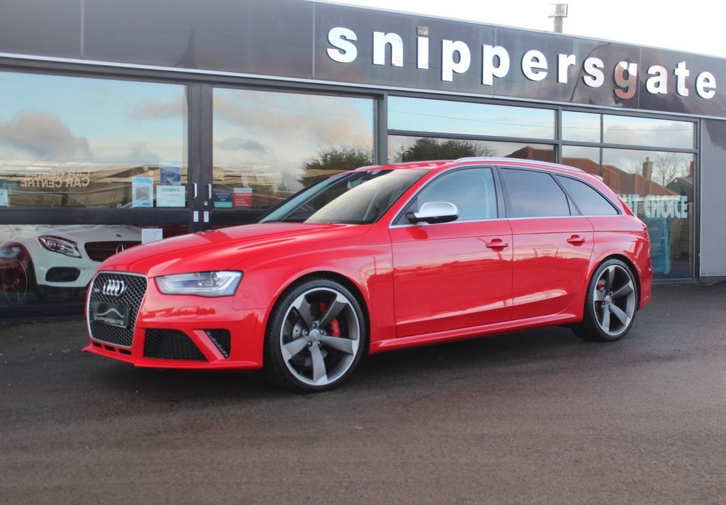 """USED 2014 64 AUDI A4 4.2 RS4 AVANT FSI QUATTRO 5d 444 BHP Misano Red Pearl Effect, Sports Package, Dynamic Steering, Sports Exhaust, Sports Suspension Plus With Dynamic Ride Control, Privacy Glass, Heated Seats, 20"""" 5 Arm Rotor Design Titanium Look Alloy Wheels With Matching Set Of Pirelli Tyres, Red Brake Calipers, Audi Hill Hold Assist, Parking System Plus, Cruise Control, Bluetooth Interface, Audi Music Interface, DAB Radio, MMI Navigation System Plus, 3 Zone Air Conditioning, Power Operated Tailgate, Auto Dim Rear View Mirror, Adaptive Headlights,"""