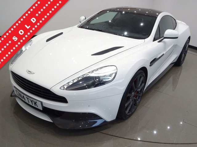 USED 2014 14 ASTON MARTIN VANQUISH 5.9 V12 (565 BHP) TOUCHTRONIC AUTO (2+2)  COUPE 2DR..CARBON..STRATUS WHITE METALLIC..BANG AND OLUFSEN..E/M/HEATED LEATHERS..RED STITCH..R/CAMERA..CERAMIC BRAKES STRATUS WHITE+CARBON+R/CAM+NAV+BANG & OLUFSEN