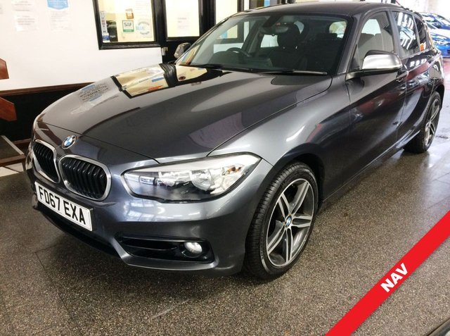 "USED 2017 67 BMW 1 SERIES 2.0 118D SPORT 5d 147 BHP Supplied with 6 months Insured RAC warranty along with breakdown cover. It is ULEZ complaint. This 118D Sport 2.0 6 Speed Diesel is finished in Metallic Mineral Grey with Black cloth seats and driver comfort pack. It is fitted with power steering, remote locking, electric windows and mirrors, Air Conditioning, cruise control, rear parking sensors, Pro Navigation, DAB Bluetooth, auto lights and mirrors, LED Day Lights, 17"" Polished alloy wheels, DAB CD Stereo with USB & Aux port and more."