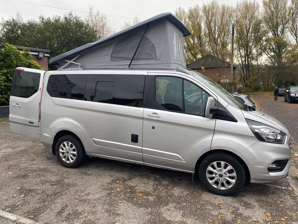 USED 2018 18 FORD TRANSIT CUSTOM 2.0 300 LIMITED P/V L1 H1 129 BHP SWB limited 2018 in Silver, 22k miles, Remainder of manufacturers warranty. Brand new conversion with: Dometic 9722 sink and hob unit , Vitrifrigo 49l 12v compressor fridge, Shurflo 10lpm water pump, Under mounted 30l fresh water tank, Under mounted 25l gas tank with electronic gauge, Autotherm 2d diesel heater, M1 tested rock n roll bed, Pop top with scenic canvas, panoramic moon roof and cassette blind  in suede, Thule Omnister awning,  240v hook up, 110ah leisure battery and B2B charger.