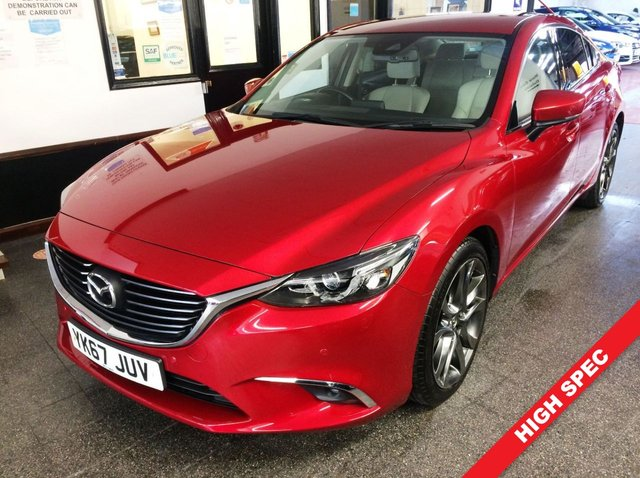 """USED 2017 67 MAZDA 6 2.2 D SPORT NAV 4d 148 BHP This Diesel powered Mazda 6 is finished in Soul metallic red with cream heated leather electric seats and heated steering wheel. It is fitted with power steering, LED lights, heads up display, Mazda satellite nav, rear camera, cruise control,  remote locking, electric windows and mirrors with power fold, climate controlled air conditioning, Bluetooth, 19"""" grey alloy wheels, BOSE Speaker upgrade, DAB CD Stereo with USB & Aux port and more. It has had one owner from new."""