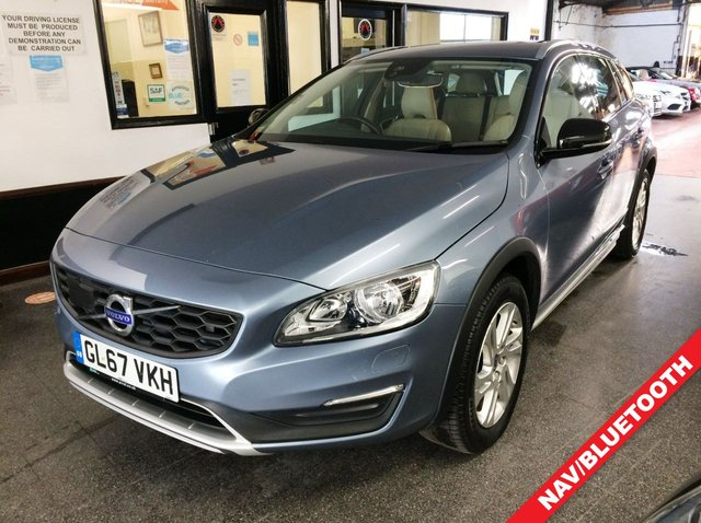 "USED 2018 67 VOLVO V60 2.0 D3 CROSS COUNTRY SE NAV 5d 148 BHP This V60 Cross Country SUV benefits from a high seating position. It is finished in Metallic light blue with cream heated leather seats. It is fitted with power steering, remote locking, electric windows and power folding mirrors, dual zone climate control, cruise control, heated front seats, Volvo Satellite Navigation, Bluetooth, rear parking sensors, auto lights, LED day lights, 17"" alloy wheels, DAB CD Stereo with Aux & USB port and more. It has had One owner from new."