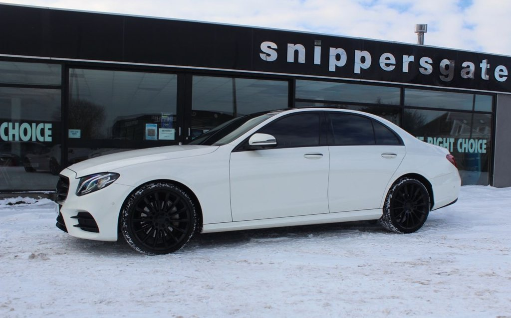 "USED 2016 66 MERCEDES-BENZ E-CLASS 2.0 E 220 D AMG LINE PREMIUM 4d 192 BHP Designo Diamond White Metallic, Full Black Nappa Leather, Panoramic Sliding Glass Sunroof,20"" AMG Multi Spoke Alloys,  360 Cameras, Heated Seats, Ambience Illumination, Keyless Go, Smartphone Integration Package, Apple CarPlay Active Park Assist, Analog Clock, Memory Package, Compartment Package, Live Traffic Capability, Tyre Pressure Control, Electric Folding Mirrors, Command Satellite Navigation, DAB Radio, AMG Styling Package, 2 Keys, Full Service History."