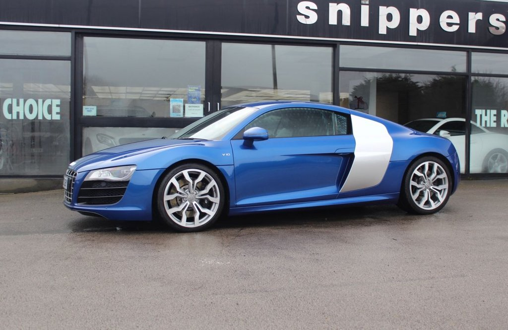 USED 2011 AUDI R8 5.2 V10 QUATTRO 2d 518 BHP Sepang Blue Pearl Effect, Extended Fine Nappa Leather Package, Audi Parking System Advanced, Bang & Olufsen Sound System, Heated Sports Seats, Navigation DVD, Oxygen Silver Side Blades, Cruise Control, Audi Music Interface AMI, Bluetooth Telephone Preparation, Storage Package, Hill Hold Assist, Electronic Climate Control, Light And Rain Sensor Package, Auto Dim Rearr Wie Mirror, High Gloss Package, Aluminium Scuff Plates With R8 Logo, All LED Headlights, Stainless Steel Pedals, Lighting Package,