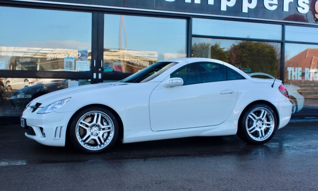 """USED 2007 07 MERCEDES-BENZ SLK 5.4 SLK55 AMG 2d 356 BHP Calcite White, Heated Black Nappa Leather, AMG Performance Package,  1 Owner From New, Parktronic System, Electric Seats, Airscarf, Memory Package, Wind Deflector, Auto Dim Mirrors, Command DVD With Navigation, Automatic Climate Control, Bi Xenon Headlights, Harman Kardon Sound System, AMG 18"""" Double Spoke Alloys, Rain Sensor, Tyre Pressure Loss Indicator, Electric Folding Mirrors, Cup Holder, Universal Telephony Package, CD Changer, Closing System With Infared Remote Control."""