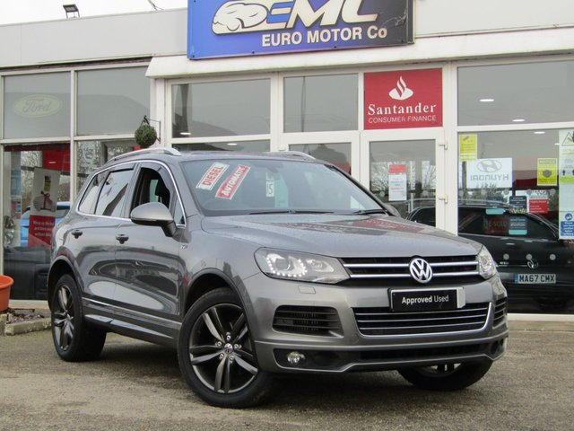 "USED 2013 63 VOLKSWAGEN TOUAREG 3.0 V6 R-LINE TDI BLUEMOTION TECHNOLOGY 5d 242 BHP Finished in CANYON GREY Metallic with contrasting HEATED EBONY LEATHER TRIM. This is a luxurious family car that is as good off road as it is on. It is spacious, comfortable and great to drive. Features include Sat Nav, Pan Roof, B/Tooth, Park sensors, Heated Leather, DAB, 20"" Alloys and much more. Dealer Serviced at 15717 miles, 25550 miles, 39001 miles, and at 46416 miles."