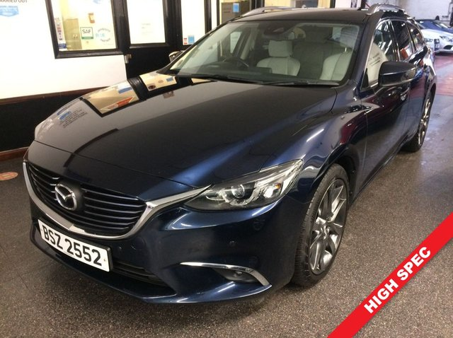 """USED 2017 MAZDA 6 2.2 D SPORT NAV 5d 173 BHP VAT QUALIFYING!. This Diesel powered Mazda 6 Sport Nav Tourer Estate is finished in Deep Crystal Blue mica metallic with cream heated leather electric seats and heated steering wheel. It is fitted with power steering, LED lights, heads up display, Mazda Satellite Nav, rear camera with front and rear park assist, cruise control, traffic sign recognition, remote locking, electric windows and mirrors with power fold, climate controlled air conditioning, Bluetooth, 19"""" grey alloy wheels, BOSE & More"""