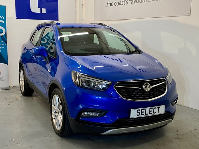 "USED 2018 67 VAUXHALL MOKKA X 1.4 ACTIVE ECOTEC S/S 5d 138 BHP Magnificent super LOW MILEAGE 2018 registered example in Boracay blue metallic with gorgeous grey cloth trim -18"" alloys,rear parking sensors,blue tooth, traction control, cruise control,touch screen ,aux in ,air conditioning,6 Speed auto lights in immaculate condition -low running costs but has nearly 140 BHP so fab to drive -this car has to be viewed with full service history even with this small mileage ! LOW RATE FINANCE available credit subject to status written details on request"