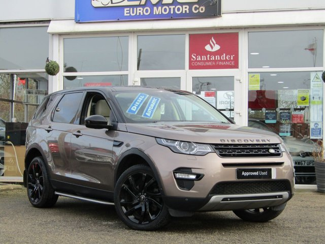 """USED 2015 15 LAND ROVER DISCOVERY SPORT 2.2 SD4 HSE LUXURY 5d 190 BHP Finished in KAIKOURA STONE MET with contrasting IVORY CLIMATE LEATHER SEATS. This Discovery Sport is practical, incredible off road and a comfy SUV that has 7 Seats that will swallow your family and luggage. FEATURES include Black Pack, Panoramic Glass Roof, Electric Rear Boot, Climate Leather Seats, Sat Nav, 20"""" ALLOYS, Heated Steering Wheel, Reversing Camera, Auto Parking and much more. STRATSTONE Dealer serviced at 4445 miles, 9994 miles, 13326 miles and at 35308 miles (independent)."""