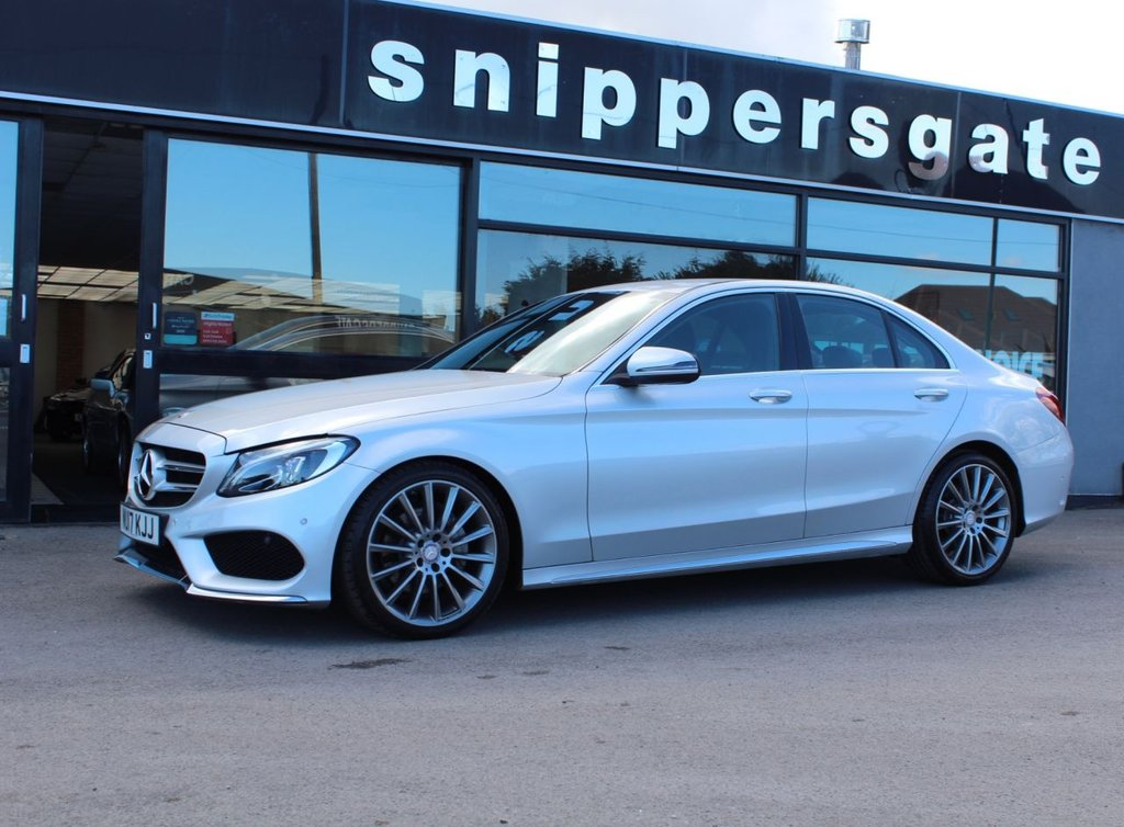 "USED 2017 17 MERCEDES-BENZ C-CLASS 1.6 C200 D AMG LINE 4d 136 BHP Iridium Silver Metallic, Rear View Camera, Heated Seats, Active Park Assist, Electric Folding Mirrors, 19"" AMG Multi Spoke Alloys, Ambient Lighting, Interior and Exterior Mirror Automatically Dimming, Cup Holder, Compartment Package, Rain Sensor, Satellite Navigation, Cruise Control, Cruise Control, 2 Keys and Book Pack, Full Service History."