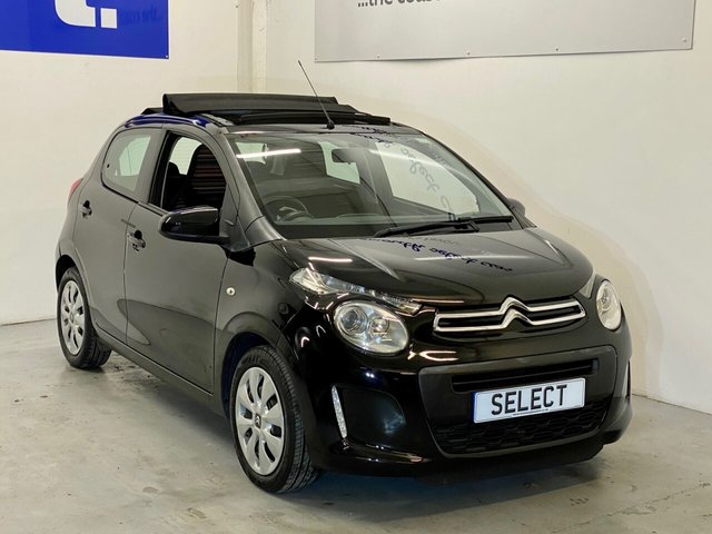 USED 2015 15 CITROEN C1 1.2 PURETECH AIRSCAPE FEEL 5d 82 BHP Fab looking New Model LOW mileage 5 door with full length electric fold back roof -feels like a Convertible !!!! Big spec too with DAB, blue tooth , Cruise Control, Ipod connectivity ,media connectivity ,Aux in , electric windows , remote central door locking and again 5 doors so super cool and good looking but practical too -great interior trim too ! Low tax and insure rating and gives great miles per gallon so a fab allrounder and finished in stylish gloss black -wow !