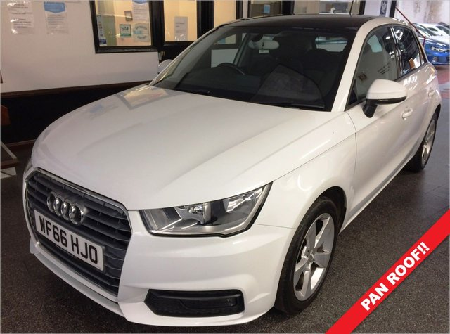 "USED 2016 66 AUDI A1 1.4 SPORTBACK TFSI SPORT 5d 123 BHP Fitted with an opening Panoramic glass roof, one lady owner from new with Full Audi Service record. This 5 door A1 is finished in Glacier White Pearlescent with Black cloth seats. It is fitted with Audi Satellite Navigation, Bluetooth, power steering, remote locking, electric windows and mirrors, air conditioning, auto lights, LED day lights, rear parking sensors, tinted rear windows, 5 spoke 16"" Alloy wheels, DAB Stereo with SD slots & Media cables and more. It has had one lady owner from new."