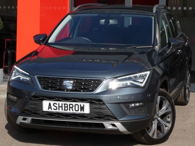USED 2018 68 SEAT ATECA 1.6 TDI SE TECHNOLOGY 5d 115 S/S 1 OWNER FROM NEW, FULL SEAT SERV HIST, SAT NAV, SPEED LIMITER, PARK ASSIST SELF STEER PARKING W/ FRONT INC REAR PARKING SENSORS + DISPLAY, 18 INCH ALLOY WHEELS, LED LIGHTS W/ DRLS, FRONT ASSIST (AMBIENT TRAFFIC MONITOR SYS), FULL LINK FOR APPLE CARPLAY ANDROID AUTO & MIRROR LINK, DAB RADIO, BLUETOOTH W/ AUDIO STREAMING, RAIN & LIGHT SENSORS, CD + 2x SD CARD READERS, AUX INPUT, 2x USB PORTS, FRONT FOGS, SILVER ROOF RAILS, GREY CLOTH INTERIOR, ELECTRIC WINDOWS, ELECTRIC FOLDING HEATED DOOR MIRRORS