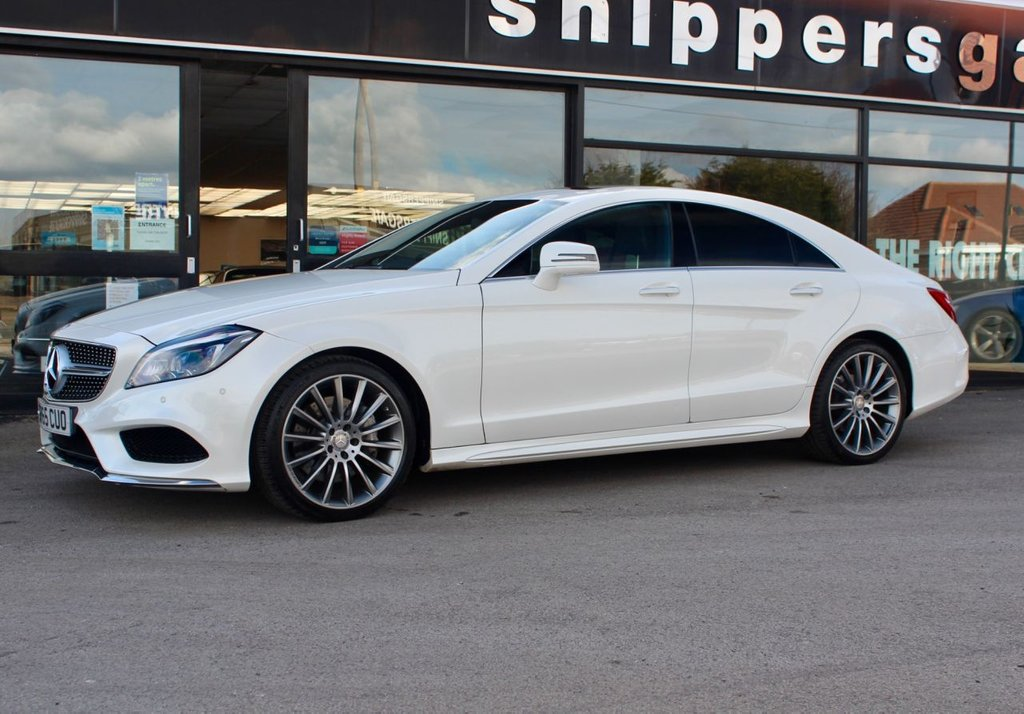 "USED 2015 65 MERCEDES-BENZ CLS CLASS 3.0 CLS350 D AMG LINE PREMIUM PLUS 4d 255 BHP Diamond White Metallic, Full Black Leather Interior, Electric Tilt Slide Sunroof, Rear View Camera, Heated Seats, Command Satellite Navigation, 19"" AMG Multi Spoke Alloys, Premium Sound System, Active Park Assist, Memory Pack, Auto Dim Mirrors, 9 Speed Automatic, Electric Folding Mirrors, Matching Set Of Michelin Tyres,  Ambience Illumination, Keyless Go, Remote Trunk Locking,  DAB Radio, Sports Suspension, Tyre Pressure Control, Automatic High Beam Switch Plus, Dynamic LED Headlamps."