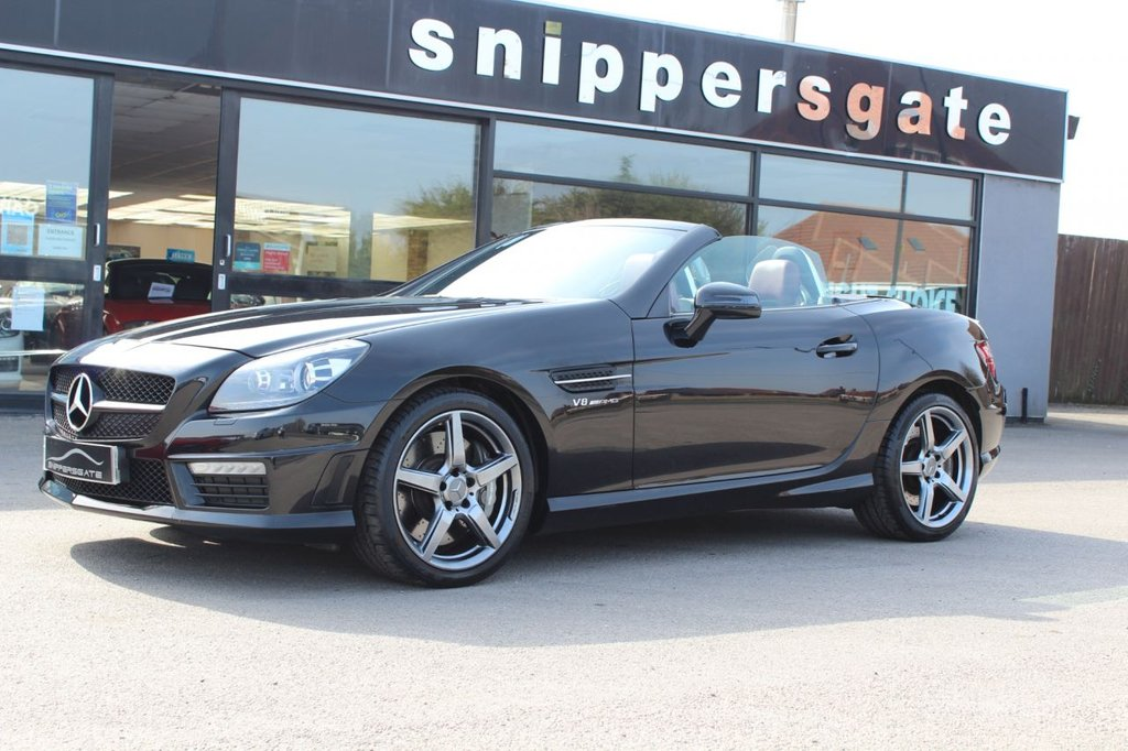 USED 2012 12 MERCEDES-BENZ SLK 5.5 SLK55 AMG 2d 421 BHP Obsidian black Metallic, Exclusive Red Leather, Magic Sky Control Panoramic Roof With Switchable Transparency, IWC Clack, Airscarf System, Harman Kardon Music, Heated Seats, Pivoting Transparent Wind Deflector, Ambience Illumination, Closing System With Infared Remote Control, Aluminium Roll Bar Inserts, Electric Seats With Memory, Ash Black Interir Trim, Cup Holder, Automatic Climate Control, Rain Sensor, Memory Package, Tyre Pressure Loss Warner, Command Satellite Navigation, DAB Radio.