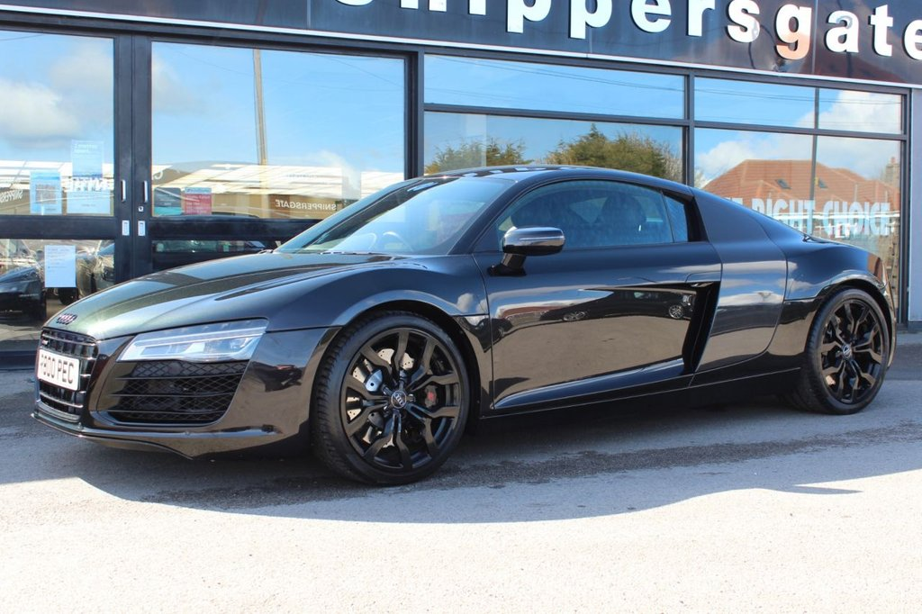 """USED 2015 15 AUDI R8 4.2 V8 QUATTRO 2d 424 BHP S Tronic Panther Black Crystal Effect, Extended Fine Nappa Leather Package In Stitched Diamond Design, Carbon Sigma Sideblades,19"""" 10 Spoke Y Design Alloy Wheels, Heated Seats,  Electrically Adjustable Seats, Audi Parking System Plus With Reversing Camera, Bang & Olufsen Sound System, Cruise Control, Black Pack, Bluetooth Mobile Preparation Voice Dialog System, Door MirrorsElectrically Folding, Adjustable and Heated, Auto Dimming Rear View Mirror, Full Leather Package."""