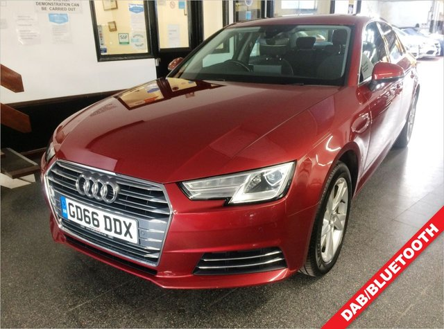 """USED 2016 66 AUDI A4 1.4 TFSI SPORT 4d 148 BHP This A4 Sport petrol 1.4 TFSi is finished in Metallic Matador Red with grey cloth seats. It is fitted with power steering, remote locking, electric windows and mirrors, tri zone climate control, cruise control, Audi Satellite Navigation including map display in centre of dashboard, Bluetooth, front/rear parking sensors, Zenon Headlights/LED day lights, auto lights, 17"""" alloy wheels, Drive select, collision damage warning, isofix,  DAB Stereo with media port and more."""