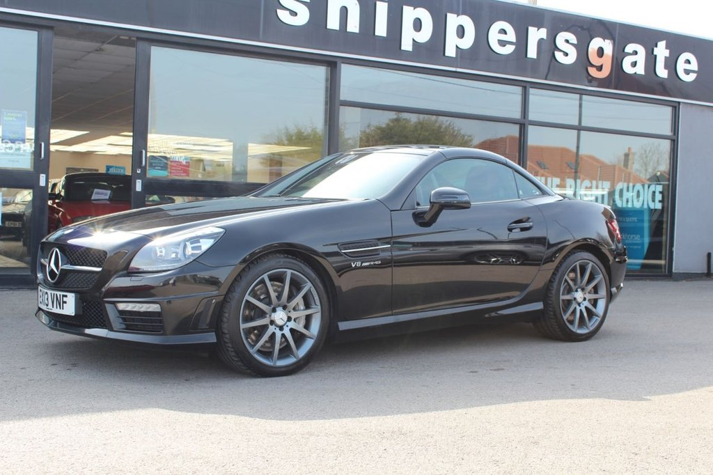 "USED 2013 X MERCEDES-BENZ SLK 5.5 SLK55 AMG 2d 421 BHP Obsidian Black Metallic, Red Full Nappa Leather, Heated Seats, Airscarf, Glass Roof, Command Online Satellite Navigation,Ambient Lighting,  Electric Folding Mirrors, AMG 18"" Multispoke Alloys, Speed Sensitive Power Steering/Vario Steering, Electric Adjustable Seats With Memory, DAB Radio, Headlamp Cleaning System, AMG Styling, Automatic High Beam Control, Traffic Sign Assist, Auto Dim Interior and Exterior Mirrors, Memory Package, Tyre Pressure Loss Warner, Cup Holder, 2 Keys an Book Pack."