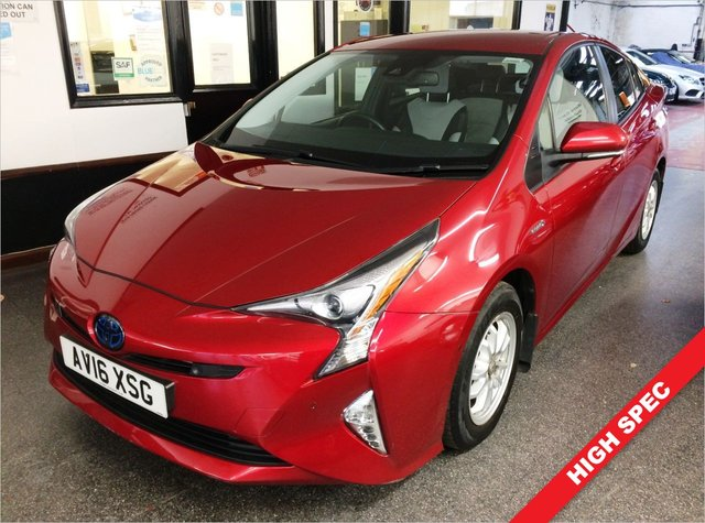 USED 2016 16 TOYOTA PRIUS 1.8 VVT-I EXCEL 5d 97 BHP Benefitting from £0 Road Tax, being ULEZ Compliant and previously Serviced by Toyota @ 11304/18677/25686/33778 miles. This Prius is finished in Pearl Hypersonic red with Cool Grey two tone leather heated seats. Its fitted with Reverse camera, self park function, Head up display, front and rear sensors, 2 Keys, Toyota Satellite Navigation, wireless phone charger, Cruise Control, lane departure warning, LED and xenon lights package, Seats Heated (Driver/Passenger), power folding mirrors + More