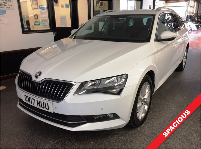 """USED 2017 17 SKODA SUPERB 2.0 SE TECHNOLOGY TDI 5d 148 BHP This highly practical Superb Estate is finished in Metallic Moon White with leather and alcantara electric memory seats. It is fitted with power steering, daylights, directional headlights, adaptive cruise control, start stop, touch screen satellite navigation, Apple Car Play/Mirror link/Android, front & rear park assist, Bluetooth, Media port, remote locking, hill assist, electric windows and mirrors with power fold, climate control, 17"""" 10 spoke alloy wheels, tinted glass, CD/SD card Stereo."""