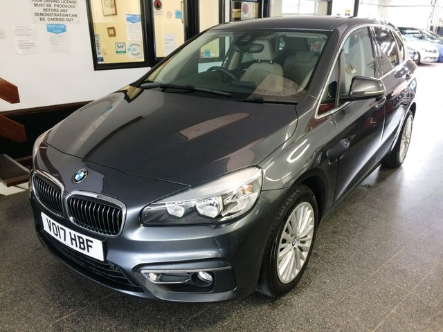USED 2017 17 BMW 2 SERIES 1.5 216D LUXURY ACTIVE TOURER 5d 114 BHP High Seated Automatic, owned previously by BMW + One private owner & Full BMW service history. This 2 Series Luxury Auto Tourer is finished in Mineral Grey with heated Oyster beige Dakota Leather. It is fitted with fully automatic gearbox, remote locking, electric windows, mirrors and tailgate, privacy glass, dual zone climate control, cruise control, front and rear parking sensors, Satellite Navigation, Bluetooth, BMW Connected Drive, three driving modes, LED Day lights, auto lights and wipers.