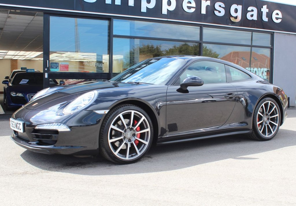 "USED 2014 63 PORSCHE 911 3.8 CARRERA 4S PDK 2d 400 BHP Extended Black Leather, Sport Chrono Package, 20"" Carrera Classic Alloy Wheels, Heated Seats, Switchable Sports Exhaust, Sports Design Steering Wheel, Satellite Navigation, Sports Design Steering Wheel, Front and Rear Park Assist,Xenon Headlights, Electric Seats, USB/Ipod Interface, Alcantara Roof Lining, Adaptive Dampers, Heated Door Mirrors, Two Zone Climate Control, LED Daytime Running Lights, Porsche Crested Headrests, 2 Keys and Book Pack, Full Porsche Service History."