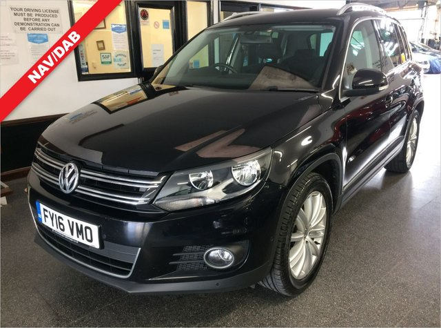 USED 2016 16 VOLKSWAGEN TIGUAN 2.0 MATCH EDITION TDI BMT 5d 148 BHP Supplied with a cambelt and water pump change, 12 months MOT and 6 months RAC Insured warranty (extendable), This diesel powered high seated Tiguan (2WD) Match SUV is finished in Black with black cloth  and suede upholstery. It is fitted with power steering, Touch Screen Satellite Navigation, remote locking, electric windows and heated power mirrors,  climatic air conditioning, cruise control, front and rear parking sensors with park itself mode, day lights, Hill Assist, Bluetooth + More.
