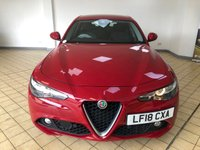 USED 2018 18 ALFA ROMEO GIULIA 2.1 TD SUPER 4d Sports Saloon AUTO in Alfa Red with Privacy Glass Black Half Leather Heated Seats Great High Spec inc Sat Nav DAB Digital Radio Bluetooth Rear Camera Front & Rear Parking Sensors Gear Change Paddles with Graphical Display Auto Lights Upgraded Alloys Upgraded Seats Alfa DNA Switch for Dynamic Normal or All Weather Driving Modes Low Mileage Recent Service & MOT New Battery now Ready to Finance & Drive Away Today  One Owner From New