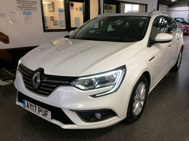 USED 2017 17 RENAULT MEGANE 1.5 DYNAMIQUE NAV DCI 5d 110 BHP NEW CAMBELT and 12 months MOT,  this new shape Megane Dynamique Estate is finished in White with Black part leather seats. It is fitted with power steering, remote locking, electric windows and mirrors with power fold, dual zone climate control, cruise control, rear parking sensors, lane assist, auto lights and wipers, LED day lights, 2 keys, Satellite Navigation, Bluetooth, Alloy wheels, DAB CD Stereo and more. It has been owned by one local company from new and comes with a full history.