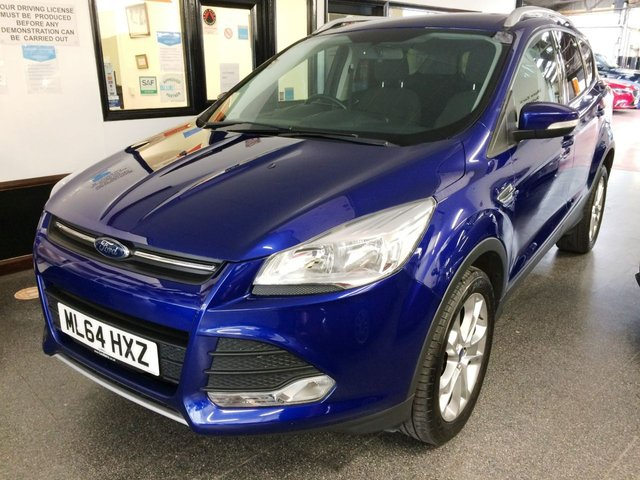 "USED 2014 64 FORD KUGA 2.0 ZETEC TDCI 5d 138 BHP Supplied with 12 months MOT, a service and 6 months Insured RAC warranty This 4WD Kuga is finished in Metallic Deep Impact Blue with Black cloth seats. It is fitted with Ford Rear park assist, Ford Bluetooth, power steering, remote locking, electric windows, mirrors, climate control, cruise control, Privacy Glass, heated front screen, push button start (2 keys), 18"" alloys, DAB CD stereo with USB, Aux port and more. It has had just two private owners. It comes with a full service history."