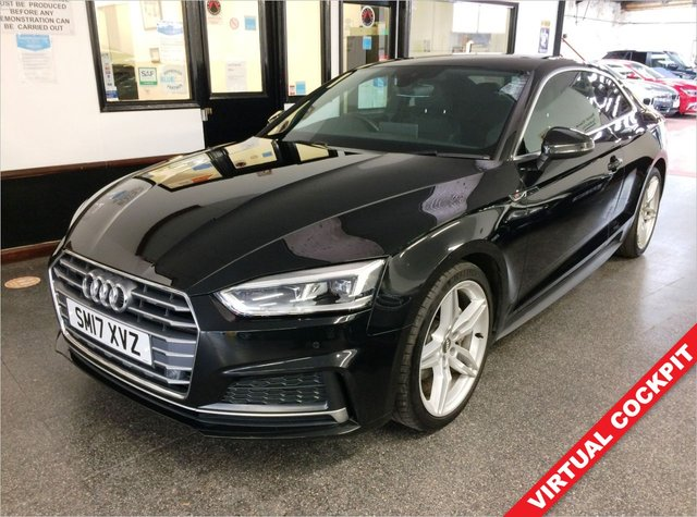 USED 2017 17 AUDI A5 2.0 TDI S LINE 2d 188 BHP Fitted with Virtual Cockpit, reverse camera & strobing indicators, this diesel  powered A5 S Line is finished in Mythos Black with Black and grey part leather and Alcantara S Line embossed heated electric seats. It is fitted with power steering, remote locking, electric windows and mirrors, tri zone climate control, cruise control, Audi Satellite Navigation, Bluetooth, camera front/rear parking sensors, LED day lights, auto lights,  alloy wheels, Drive select, collision damage warning + More.