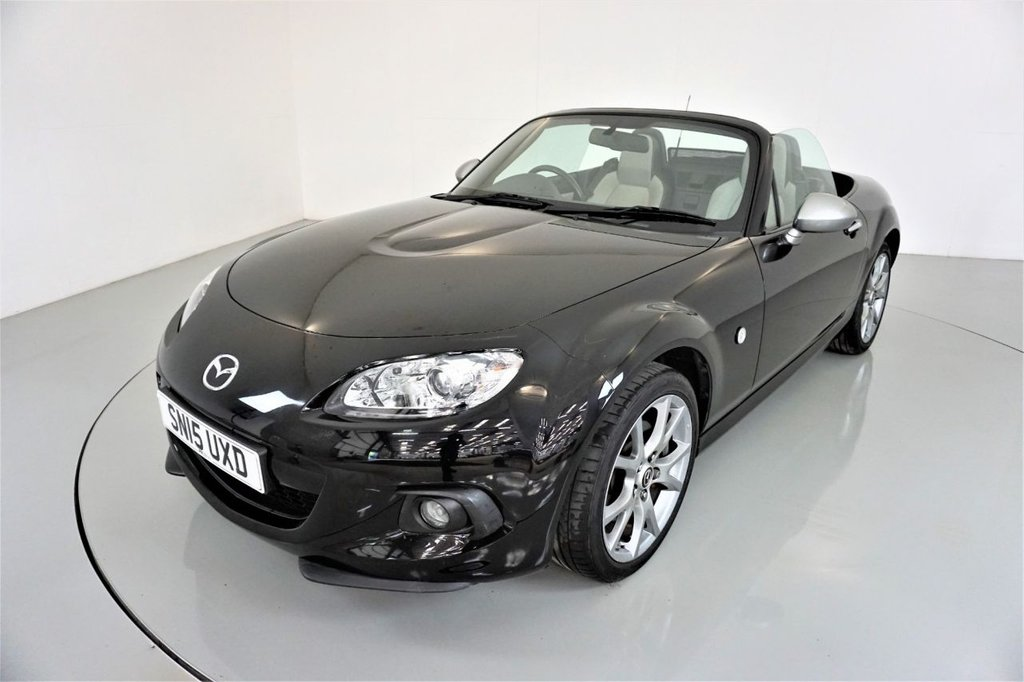 USED 2015 15 MAZDA MX-5 1.8 I SPORT VENTURE 2d-2 OWNER CAR-LOVELY LOW MILEAGE EXAMPLE-The Mazda MX-5 Venture is a special limited edition of the worlds most popular open top sports car. It features an upgraded and luxurious specification, advanced technology, premium interior trim and exterior colours exclusive to this particular model. Its stand out specification includes 17-inch alloy wheels, front fog lights, chrome front grille, piano black fashion bars and special Venture Edition badging. Inside, the MX-5 Venture Roadster has heated leather seats, leather steering wheel and hand brake with contrasting grey stitching, matching door trim, climate control, air-conditioning, piano black dashboard accents, alloy pedals, cruise control, heated seats and a satellite navigation system featuring a fully integrated 5.8-inch touch screen monitor, 4GB SD card based map (45 countries), live services, and iPod and Bluetooth connectivity complete with multi-media functionality. Renowned as a fun, everyday sports car, this particular MX-5 Venture is the 1.8 Roadster version and is one of only 500 cars in the UK
