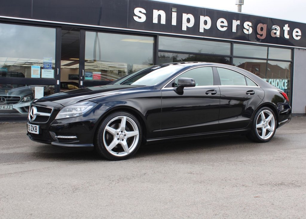 """USED 2013 63 MERCEDES-BENZ CLS CLASS 2.1 CLS250 CDI BLUEEFFICIENCY AMG SPORT 4d 204 BHP Obsidian Black Metallic, Full Black Leather, Rear View Camera, Active Park Assist, Heated Seats, Ambience Illumination, AMG Sports Pack, Command Satallite Navigation,  LED Daytime Running Lights, Auto Dim Mirrors, Sports Steering Wheel, Tyre Pressure Loss Warner, DAB Radio, Ash Tree Black Wood Trim, 19"""" AMG Alloys, AMG Styling Pack, Full Service History."""