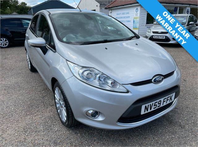 USED 2010 59 FORD FIESTA 1.6 TITANIUM 5d 118 BHP ONE YEAR WARRANTY INCLUDED /  ONE OWNER CAR / FULL HISTORY X 10 STAMPS / VOICE COMMS / USB/ BLUETOOTH / CRUISE CONTROL
