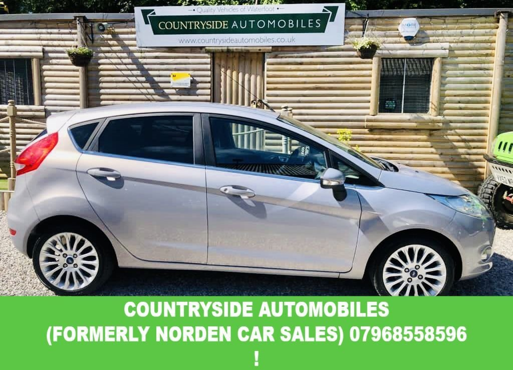 USED 2012 12 FORD FIESTA 1.4 TITANIUM 5d 96 BHP Here we have a clean and tidy example of a top specification Fiesta 1.4 Titanium. comes with a full mainly main dealer service history done @ 12k , 24k, 35k , 43k , 47k , 57k and will be done again by us before collection. Very good specification with DAB radio, Cruise control, Climate control, Blue-tooth, Privacy glass and 16 in Alloy wheels.