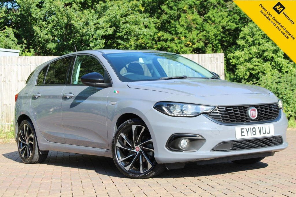"""USED 2018 18 FIAT TIPO 1.4 S DESIGN 5d 118 BHP ** 1 OWNER FROM NEW ** FULL SERVICE HISTORY ** NEW SERVICE + ADVISORY FREE MOT - EXPIRY MAY 2022 ** SAT NAV ** HALF LEATHER ** REAR PARKING AID + CAMERA ** CRUISE CONTROL ** CLIMATE CONTROL ** DAB RADIO + USB ** BLUETOOTH ** AUTO LIGHTS + WIPERS ** 18"""" DIAMOND CUT ALLOY WHEELS ** ULEZ CHARGE EXEMPT ** NATIONWIDE DELIVERY AVAILABLE ** BUY ONLINE IN CONFIDENCE FROM A MULTI AWARD WINNING 5* RATED DEALER **"""
