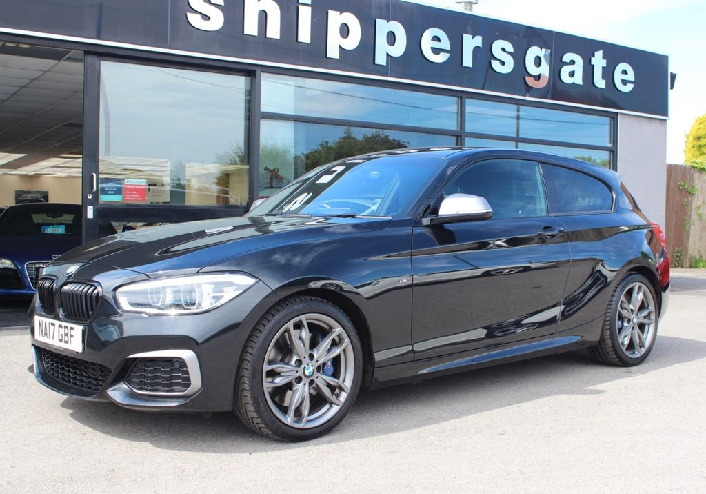 USED 2017 17 BMW 1 SERIES 3.0 M140I 3d 335 BHP Saphire Black Metallic,1 Former Owner, Heated Seats,  Navigation System Professional, Harman Kardon Music System,  M Sport Brakes, Tyre Pressure Display, LED Headlights,  Variable Sprt Steering, Sun Protection Glazing, Sports Seasts, Storage Compartment Package, Retractable Armrest, Park Distance Control, Rain Sensor, Cruise Control With Brake Function, DAB Tuner, Hands Free With USB Interface, Instrument Pannel With Extended Scope, 2 Keys and Book kPack, Full Service History.