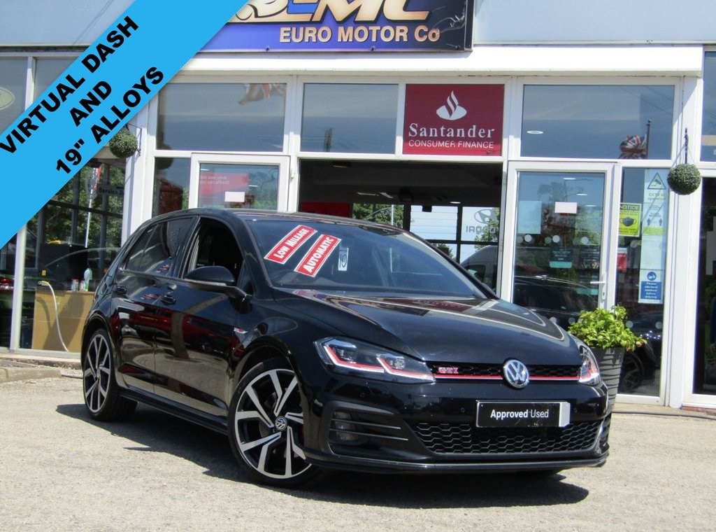 """USED 2019 68 VOLKSWAGEN GOLF 2.0 GTI PERFORMANCE TSI DSG 5d 242 BHP Finished in DEEP BLACK PEARL, with contrasting RETRO grey checked sports interior. This is a 1 former owner classic HOT HATCH. Performance as the name suggests is very lively and makes an Ideal quick Family Hatch. Features include 19"""" Alloys, LED run Lights, Virtual Dash, Heated Seats, SAT NAV, DAB, B/Tooth, Cruise, Power Folding Mirrors and Park Sensors. VW Dealer serviced at 6965 miles and at 13203 miles."""