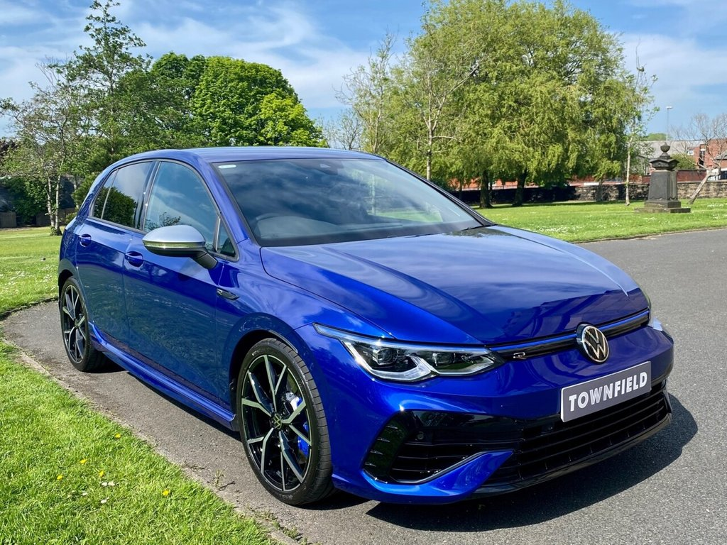 USED 2021 21 VOLKSWAGEN GOLF  R 2.0 TSI 4MOTION DSG 5d AUTO 316 BHP The Latest and Most Powerful Production VW Golf R. Finished in Metallic Lapiz Blue Metallic with Optional Carbon Nappa Leather Heated Seats and Delivery Miles and a Fantastic Specification to Include: Upgraded 19 Inch Estoril Alloy Wheels, Virtual Digital Dash, Satellite Navigation + Smartphone Interface + Upgraded Harmon Kardon Premium Sound + Bluetooth Connectivity + DAB Radio, Digital Dual Zone Climate Control, Heated Leather Multi Function Sports Steering Wheel, Cruise Control